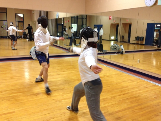 Sarah Bernt ('13) and Dante Popple ('09) suit up and face off in SR's new Fencing Club.